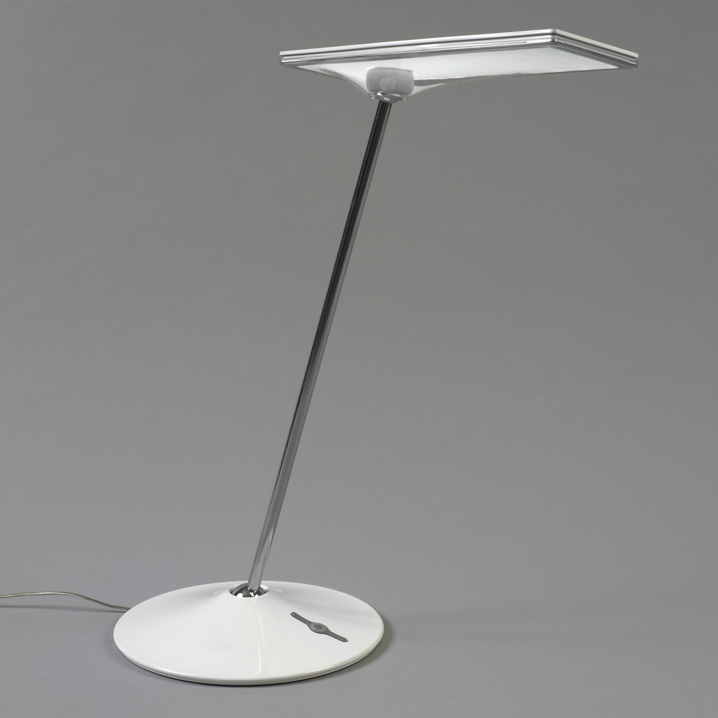 Horizontal rectilinear head mounted on thin metal shaft surmounting circular base; ball-joints at top and bottom of shaft allow user to tilt and change orientation of lamp head. Dimmer switch in base.
