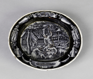 """Limoges enamel small plate decorated en grisaille, with flesh tones and heightened in gold, depicting peasants shearing sheep, captioned: """"IVNIVS"""". On reverse, lobster at center encircled by scrollwork and a winged putto and lion."""