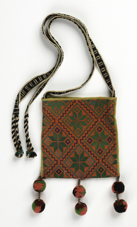 Flat square bag with top opening. Black and white strap with plaited ending on either side of opening. Tassels on bottom. All-over design in solid wool of diamonds framing stylized rosettes in green, gray, purple on salmon ground.