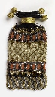 Small flat bag of crocheted silk attached at the top to two gold bars with filligree balls at the ends, with a gold sliding ring. The design is composed of horizontal bands of geometric design in black, orange and off-white with gold-colored and cut steel beads. Looped beaded fringe at bottom alternates strings of cut steel with gold-colored beads.