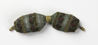 Crocheted in light green with floral bands of darker green and cerise silk, ornamented with bands of gold-colored beads. One gold ring controls opening, gold drops at each end.