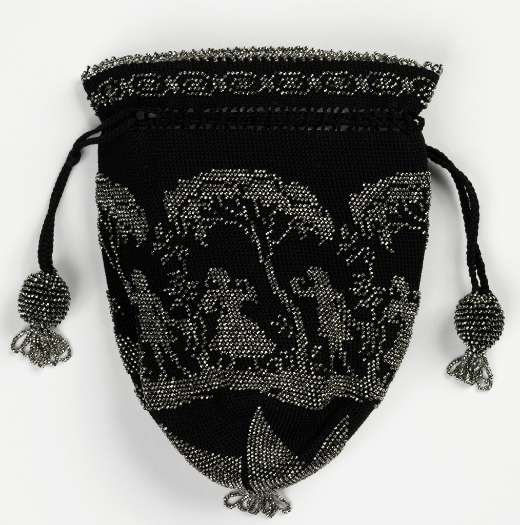 Purse of black silk, crocheted and ornamented with cut steel beads in a design of tress with figures dancing below. A star forms the base, with a simple border and edging at the top; draw string with ball ends.