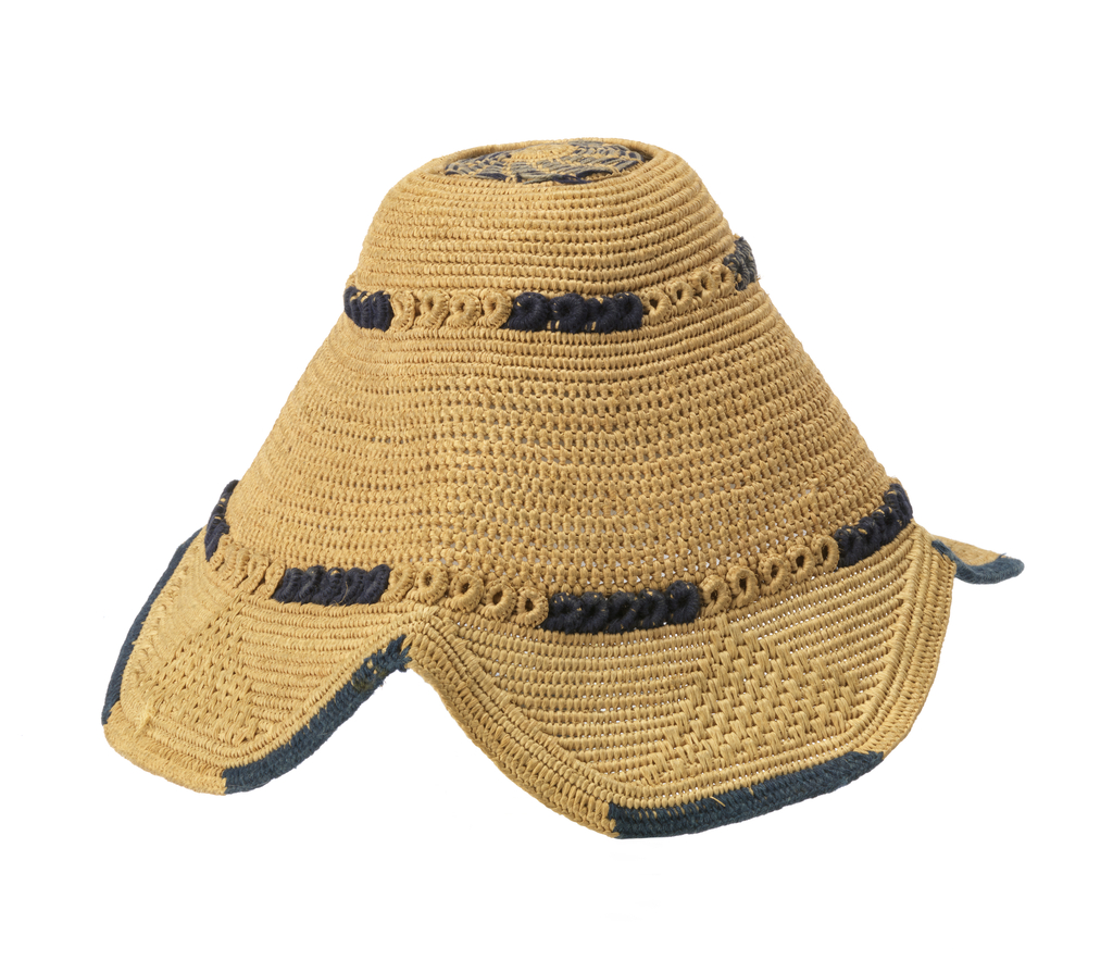 Shallow conical hat with four lobes at the lower edge. Openwork circle at crown, two encircling rings of small buttonholed scrolls, buttonhole stitch around lower edge.  Natural raffia color with touches of blue wool in two shades.