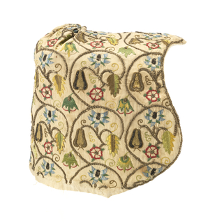 Woman's coif of off-white linen, with a point over the forehead, shaped at the cheeks, and with a pleated detail at the crown. Embroidered with scrolling stems in gold thread framing flower and pears embroidered in colored silks in blues, greens, yellow and red.