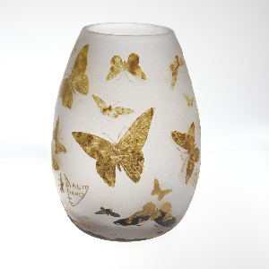 Bulbous vase depicting various brown-beige butterflies all over white background.