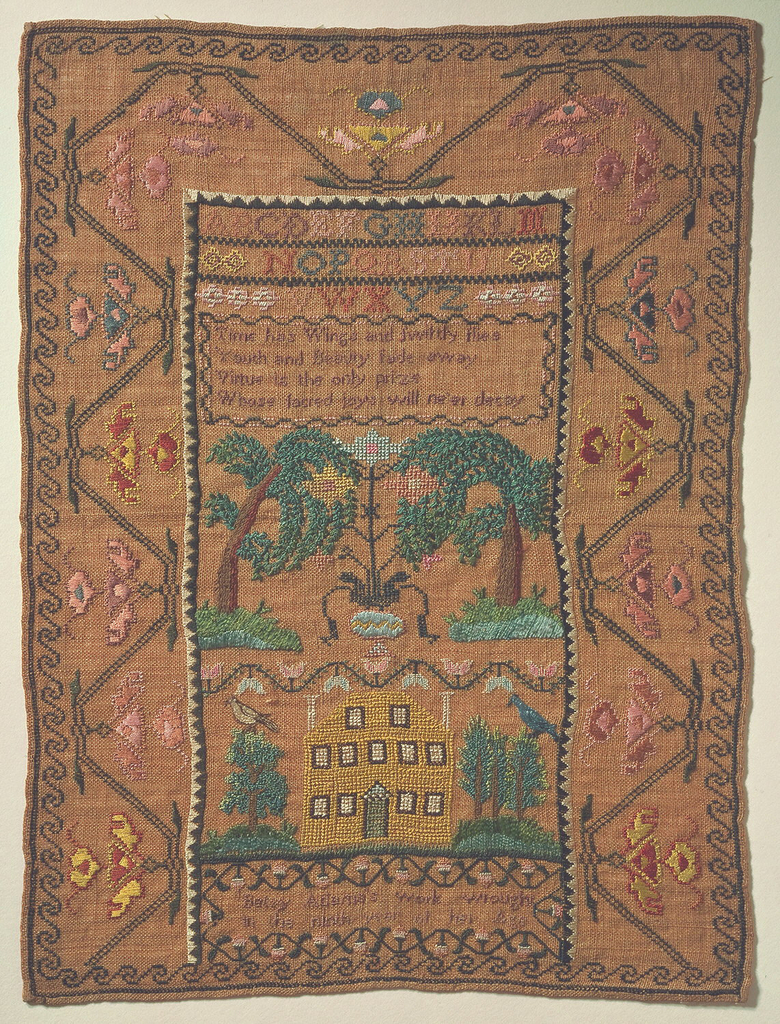 The center field contains an alphabet, a verse, trees and a large house. With a wide floral border on three sides, and an inscription at the bottom.