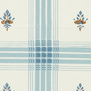 Blue plaid design with small red and blue floral motifs in center, on glazed white ground.