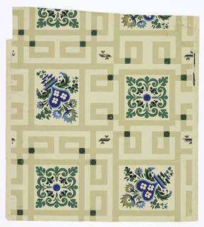 On cream ground, maze-like pattern in darker shade of beige with squares of foliate patterns printed in green and blue.