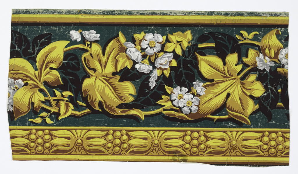 Frieze with ivy leaves and flowers. Across bottom, simulated palmette molding. Printed in yellows, browns, grays and black on green ground.