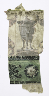 Upper part of border shows large vase or urn in grisaille. At right and left may be seen portions of the tails and wings of addorsed griffins. The ground color on the upper portion has a pink or mauve coloring under losses of printed colors. Portion of green band with rosette at bottom.