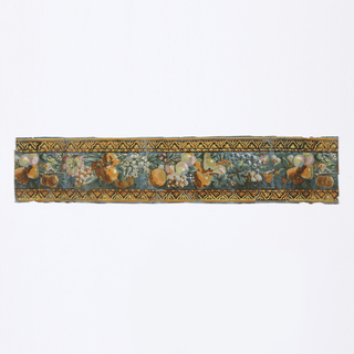 Narrow border with fruit and floral center band with gold anthemia bands running along either edge.