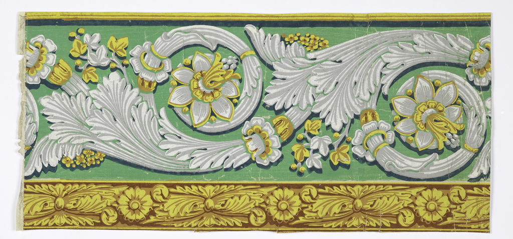 The primary design consists of an acanthus rinceau punctuated by daffodil-like flowers and interspersed with clusters of small conventional flowers and maple leaves. Beneath this band, a narrow foliate edging alternates rosettes with acanthus-derived motifs.