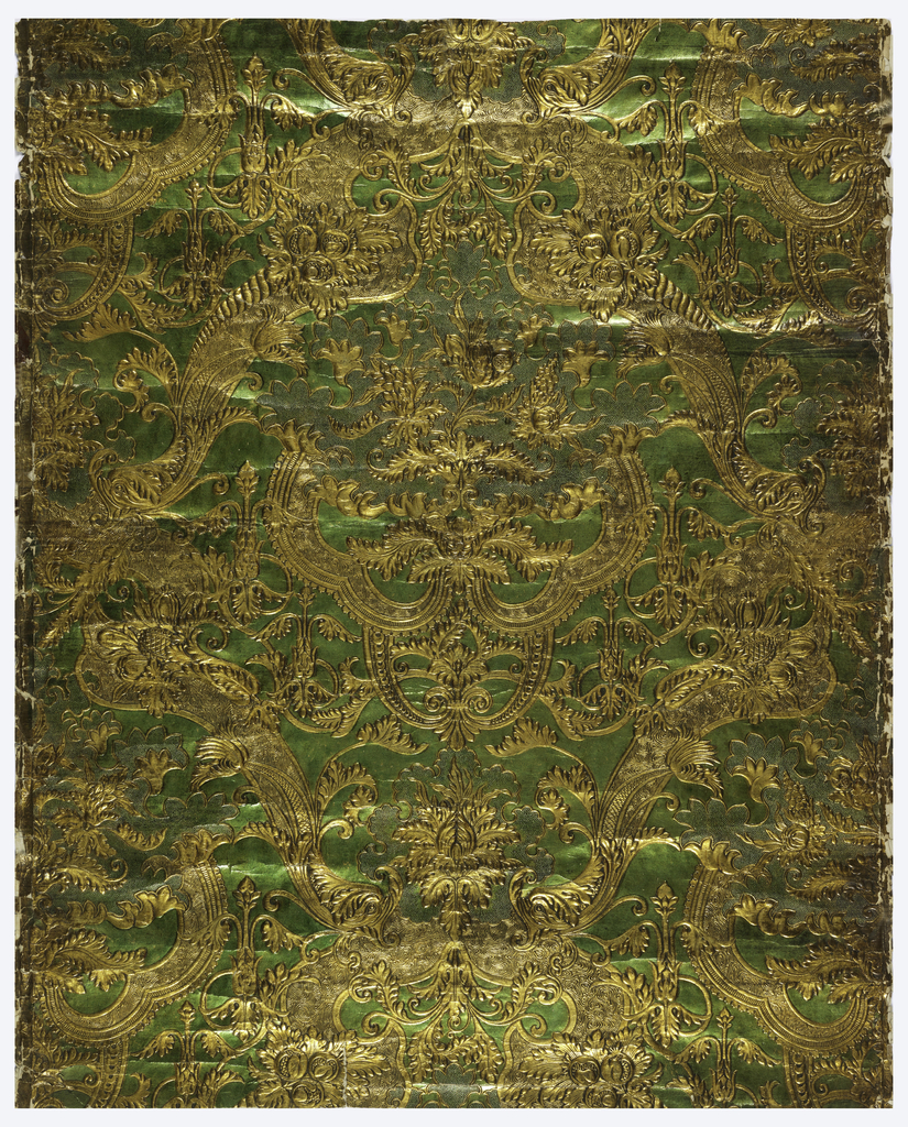 Embossed symmetrical rococo floral and foliate pattern, with some areas in stippled texture; printed in metallic bright green and metallic gold.