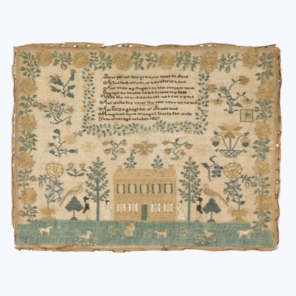 Male and female figures, trees, birds, and urns of flowers are symmetrically arranged on either side of a large house, with grass and domestic animals in front. A deep yellow rose border surrounds the sampler on three sides. In the upper half, a box framed by a smaller floral vine border contains a verse and inscription.  The verse reads: Jesus permit thy gracious name to stand As the first efforts of a youthful hand And while my fingers on the canvass move Engage my tender heart to see thy love With thy dear children let me have a part And write thy name thyself upon my heart