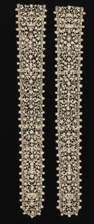 """Candlestick"" pattern of floral and foliated forms in high relief. Straight outer edge interrupted at intervals by clusters of blossoms."