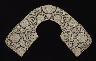 Man's collar of Brussels-style lace in a pattern of stylized floral and foliated forms in a large scale symmetrical arrangement and connected by brides.