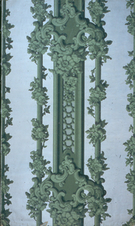 Full width giving slightly more than one repeat of vertical framework set with floral clusters and interrupted at regular intervals with cartouche of rococo scrolls. Greens on white embossed ground.
