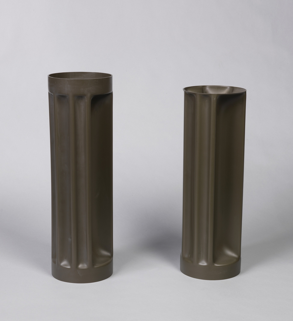 Black cylindrical fluted vase.