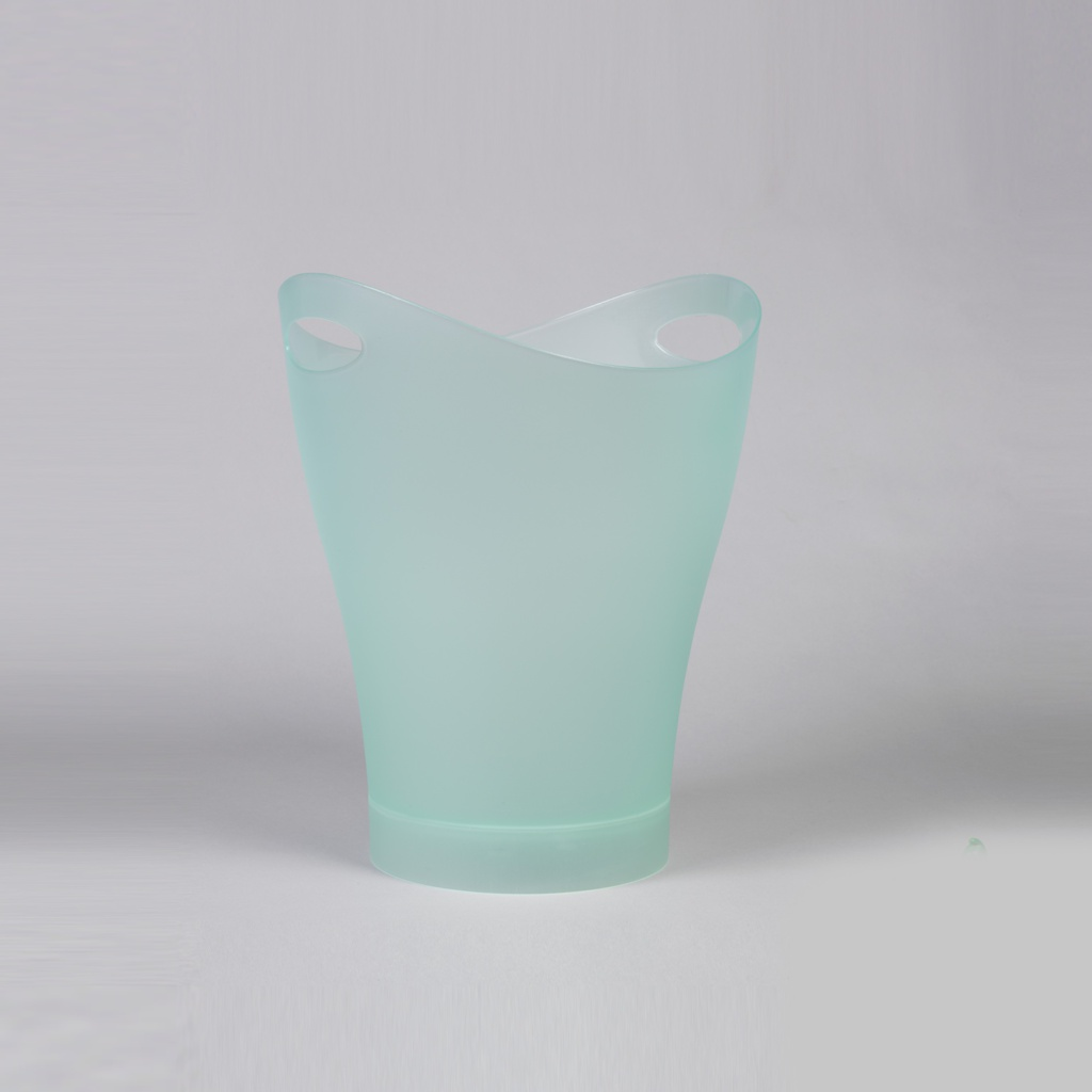 Small frosty-green trash can; oval mouth pierced on either side with holes for hand grips, tapering to circular base.