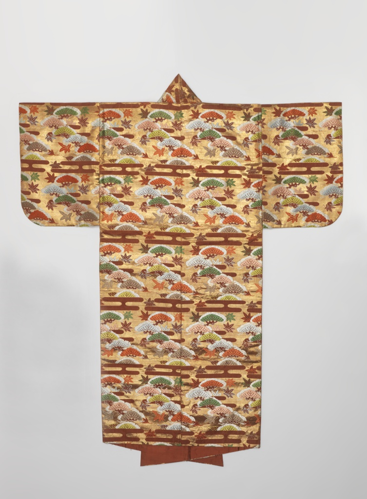 Theatrical robe of deep terra-cotta silk twill brocaded in polychrome silks and gilded metal. Design of clouds, pine tree and leaves. Lined with deep terra-cotta silks.