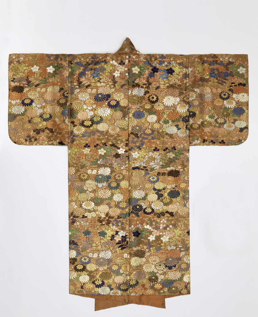 Noh theatrical robe of terracotta silk twill brocaded heavily in colored silks and gilded paper with a design of chrysanthemums and five-petal flowers. Lined with solid terracotta silk.