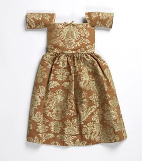 Child's dress of coral-colored silk damask with floral pattern in white. Bodice cut square at neck and edged with pink ribbon; elbow length sleeves; full gathered skirt.