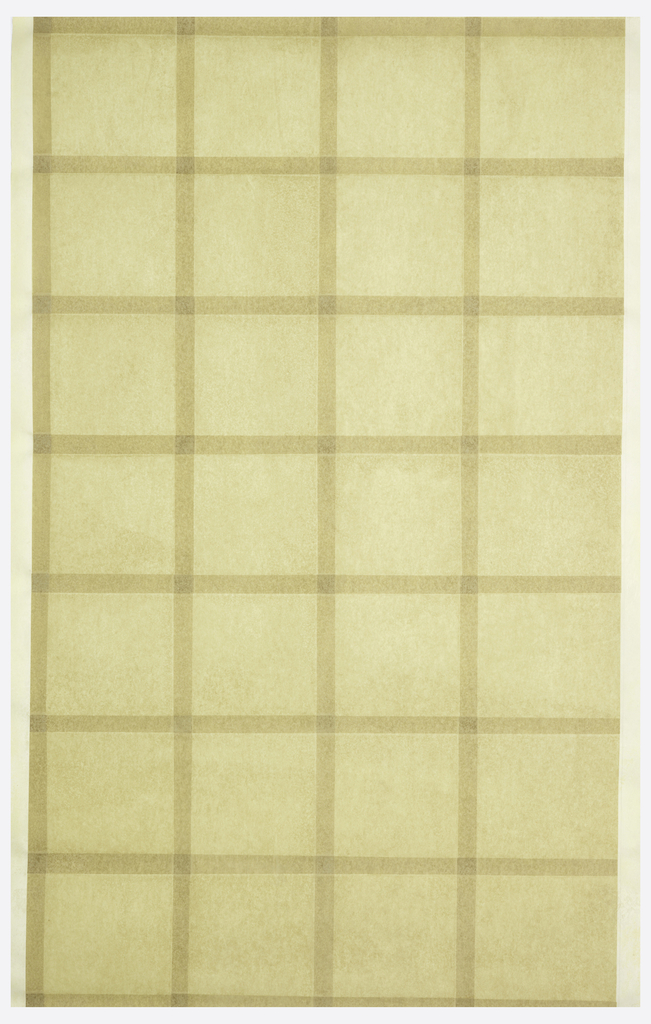 All-over pattern of tan squares of paper cut and pasted with one inch overlap.