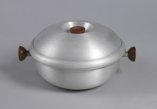 Circular, with two projecting wooden knob handles at opposite sides, lid has wooden knob.