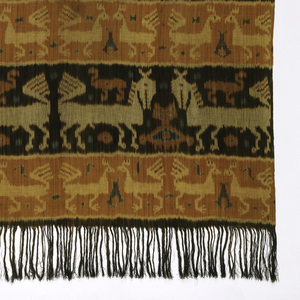 Men's wrapper (hinggi) with horizontal bands displaying horse, bird (maybe rooster), and snake or 'naga' motifs. Also features a middle band of diamond lattice. Colored in black, orange, tan, white, and blue. Warp fringe at both ends.
