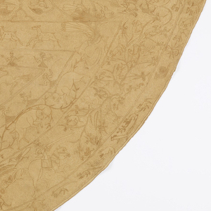 Semi-circular cape with a central square flanked by two wedge shapes and framed by multiple borders, all filled with a variety of fantastic and naturalistic birds, animals, and hunters on horses or elephants. In golden tan Tussah silk in fine chain stitch with outline and knot stitch fillings and accents on cotton ground, now mellowed to a light brown color, and covered with a fine scrolling leaf pattern in same silk in outline stitch. Similar cotton backing caught in with some of the quilting and major areas of embroidery.