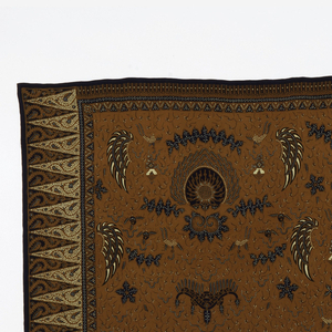 Narrow length of batik in brown, dark blue, white, and tan.Tumpal motif (row of isosceles triangles) at ends and large sawat or mironj motif (wings of Garuda, mount of Vishnu) throughout field. Small mount meru motif (three-humped line) mixed in with smaller short curving lines in ground. Thin border with geometric pattern surrounding field with another thin geometric border at the sides.