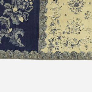 Long horizontal panel. Three-fourths of the sarong (the body or 'badan') is patterned by isolated floral sprigs on an ivory background, repeating. The remaining fourth on the left is a panel (the head or 'kepala') with a curving branch with elaborate blossoms and leaves on a blue background. Each area is defined by two borders--one a floral vine and the other a repeat of elaborate leaves. The major area has an additional inner border of a spidery floral vine.