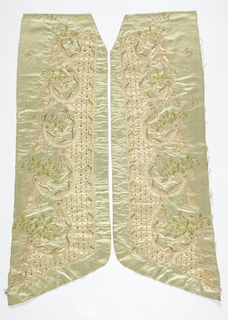 Long shaped panel from the left side of a robe. Pale blue satin embroidered in colored silks with accents of brilliants and paper roses. Parts of the design are outlined using white feathers. Overall pattern is garlands gathering clusters of small flowers. Appliquéd border of white satin embroidered in an imbricated pattern with a diamond-shape drop in each scale.