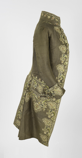 Ribbed silk in narrow perpendicular stripe of green and brown. Elaborately embroidered in multi-colored silk; floral design with small areas of applied silk, also embroidered. Style slightly cutaway. Standing collar, embroidered. Eight large embroidered buttons.