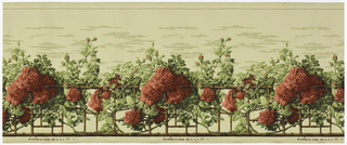 A bamboo trellis is covered with climbing rose vines with numerous large red roses and buds. Above the trellis is a clouded sky. Printed in red, green and brown on beige ground.