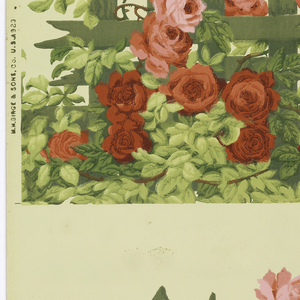 Frieze for a crown decoration. The top of a picket fence-like trellis covered with red and pink climbing roses. Printed in green, red and pink on a yellow-green ground.