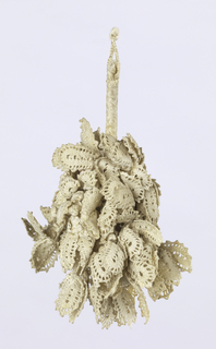 White linen tassel braided over an inner stem, terminating in a round ball from which hang many short braided stems terminating in bobbin lace petals. Center ball surrounded by tiny knots.