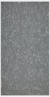 All-over irregular pattern of soft white spatters on dark grey ground; effect reminiscent of cut stone or fabric streaked with fluff.