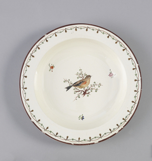 Flat, straight marly, decorated with overglaze maroon edge, maroon and green foliated and interlaced lines. In center of (a), warber-like bird with red wing, turned right; (b) with purple wing, turned left.