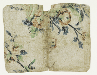 Portion of an urn with floral sprays. Printed in green, blue, black and faded pinks. The paper is not white, but a light brown, and has a coarse texture. Formerly used as a book cover.