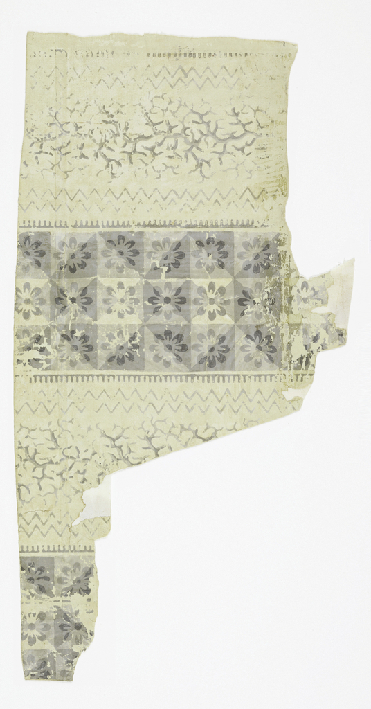 Almost complete width of paper with alternating vertical bands, a white, with grey chevrons and vermiculations, and a dark, with shaded squares enclosing fleurons.