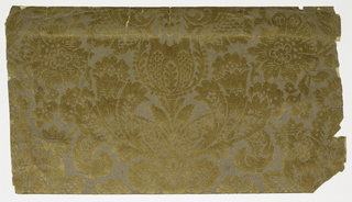 Full width giving less than one repeat of vertically developed symmetrical design of foliate and floral forms suggesting damask of the early 18th century. Printed in light brown flock on neutral brown ground on embossed paper.