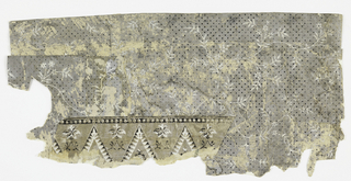 On gray ground, fill of black dots, small scale pattern of meandering vine, foliage and flowers over-printed in white. Fragments of grey paint along edges on reverse.