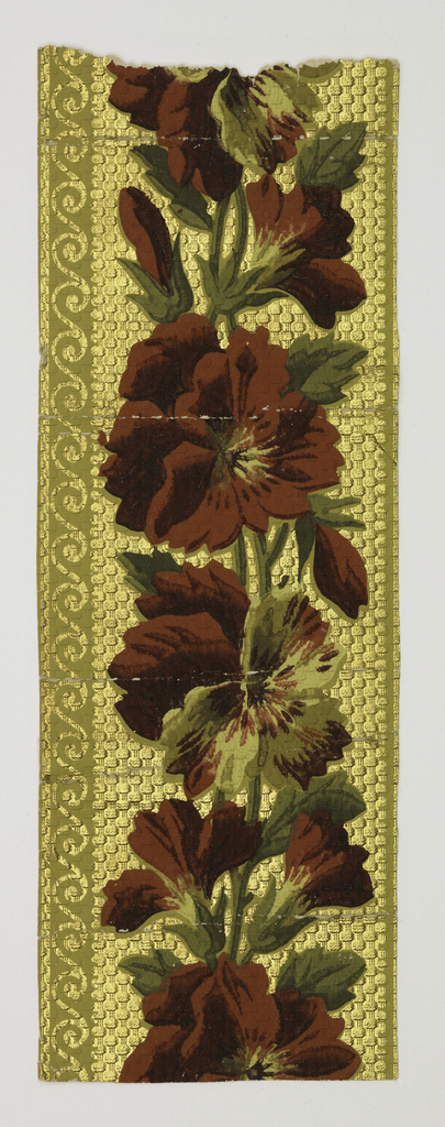Aesthetic style. Wide central band of vining floral motif. Narrow band of scalloped edge along top. Band of wave scroll along bottom edge. Printed in shades of red and green on embossed mtallic gold ground. The ground is embossed to simulate a textile weave.