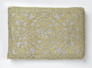 Rectangular pillow cover in reticella; central design of female figures with four-footed animal.