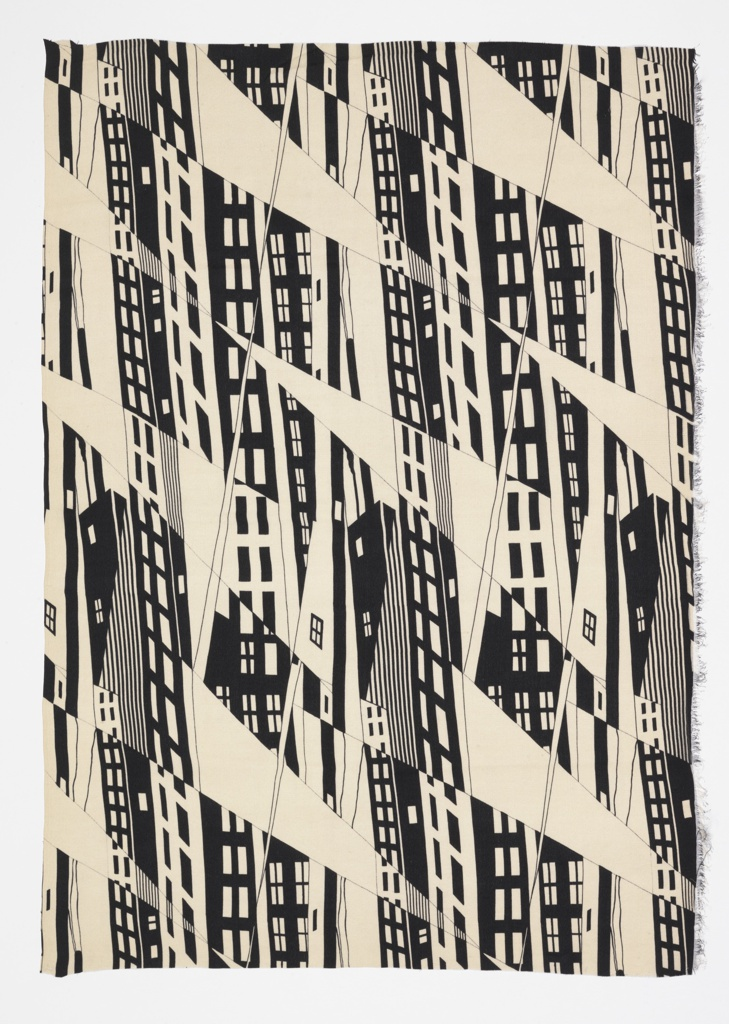 Fragment of printed dress silk with an abstracted design of skyscrapers with diagonal shafts of light playing off the facades. In black and white, with reversals of positive and negative space.