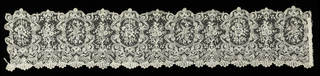 Lace border with a fine net ground with designs in bobbin lace applied by hand. Medallions frame alternately birds with extended wings and quivers with arrows; with sprays of flowers in between. Surrounded by scrolling lines, scalloped edge top and bottom.