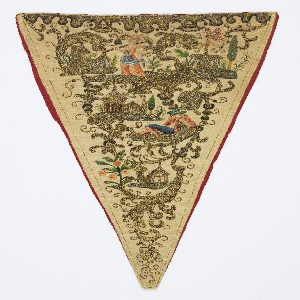 Triangular stomacher in ivory silk, heavily embroidered in gold metallic yarns with scrolling leaves framing small buildings, and, in colored silks, a female figure with a rake over one shoulder, a male figure dozing, and a butterfly.