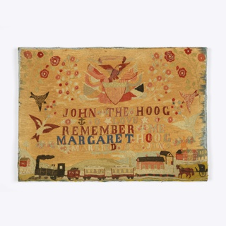 At the top, an eagle with spread wings is perched atop a shield, with flags and buntings, surrounded by floral sprays. At the bottom is a landscape with a small town, a locomotive, and a horse and carriage. In the center is the inscription: John the Hoog O Love Remember me Margaret Hoog Married 1875 June 3, surrounded by birds and flowers. The entire surface is covered with chain stitch embroidery.