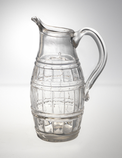 Blown-three-mold barrel-shaped body; pouring spout; loop handle; ground pontil mark bottom.